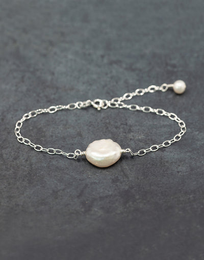 Sterling silver bracelet with freshwater keshi pearl and sterling silver beads.