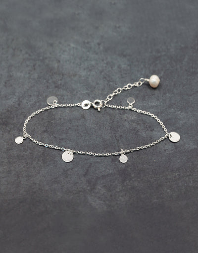 Sterling silver bracelet with silver disks & fresh water rice pearl.