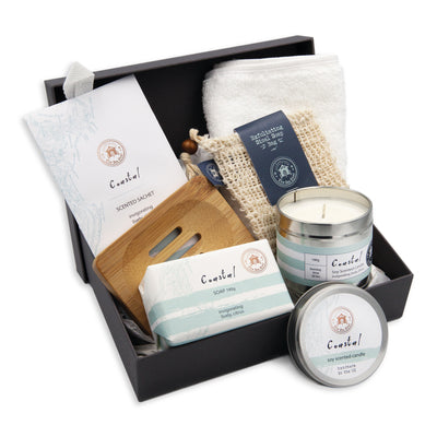 Coastal soap 190g, Coastal soy scented candle tin, Coastal scented sachet and an exfoliating soap bag, cotton face cloth, wooden soap holder