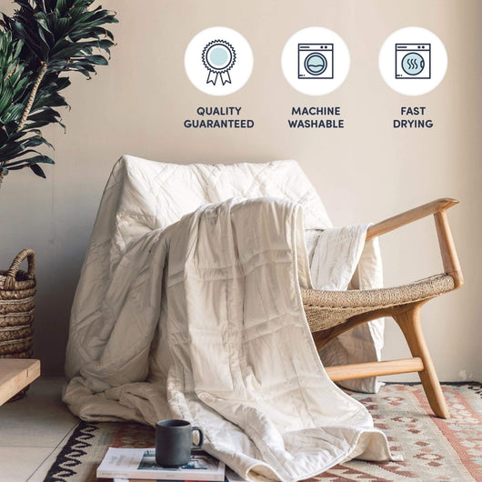 White Weighted Throw Blanket draped over a chair