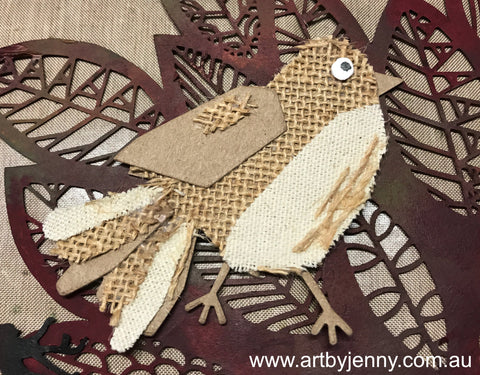 diecutting birds out of scrap fabric and leftover cardstock