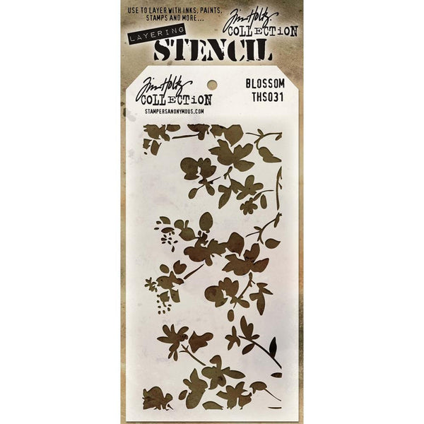 Tim Holtz layering stencil. Pretty fronds of flowers and leaves with what could easily be a little bird perched on a branch.