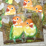 Love Birds on ATCs with Feather stamps in the background