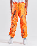HAUS Party Track Pants - Orange with paint detail