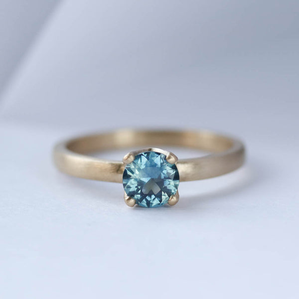 Teal Montana Sapphire Solitaire Engagement Ring in yellow gold