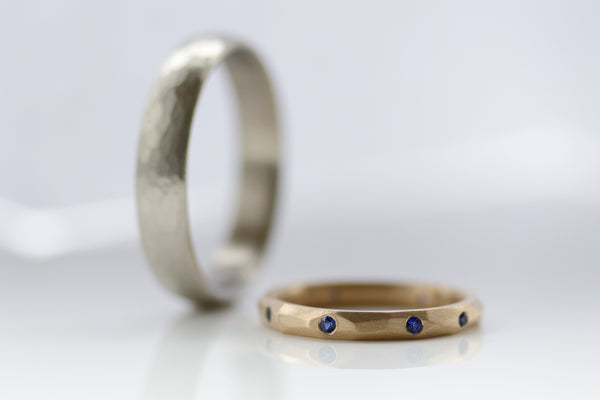 Faceted Yellow Gold Women's Wedding Band with Flush-set Dark Blue Lab-grown Sapphires