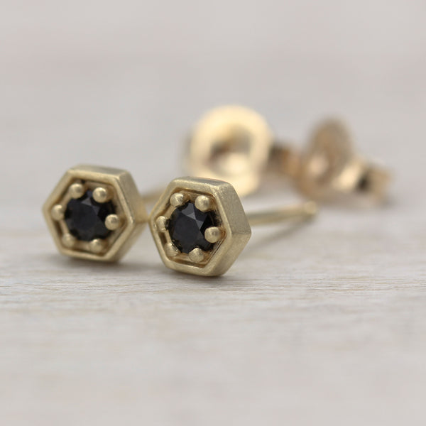 Aide-memoire Jewelry's Hexagon Stud Earrings, in 14k yellow gold with fair trade black spinel