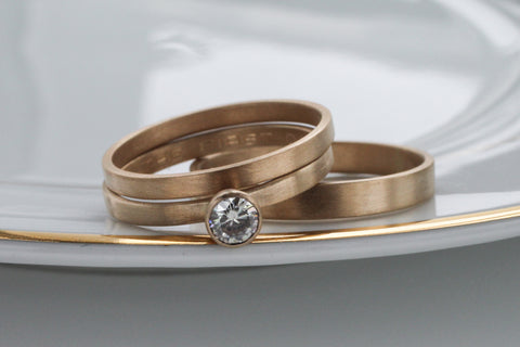 14k yellow gold bridal wedding ring set.