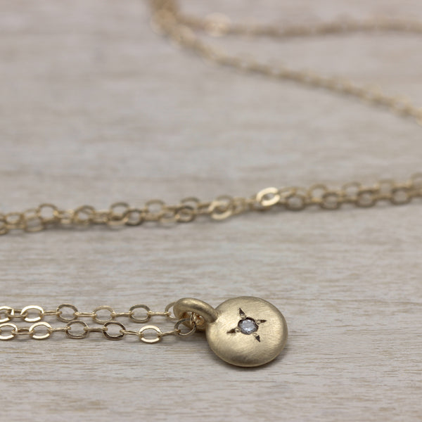 Aide-memoire Jewelry's Small Smooth Bead Set Pendant Necklace, in 14k yellow gold with a diamond, handmade in Seattle