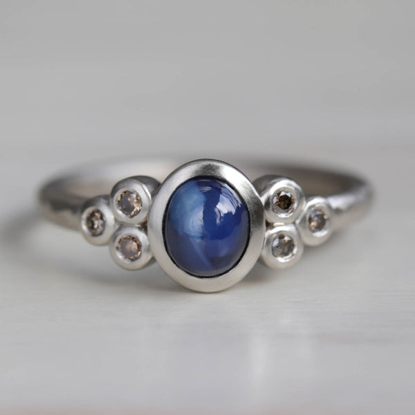 Seven Stone Cluster Ring with Sapphire