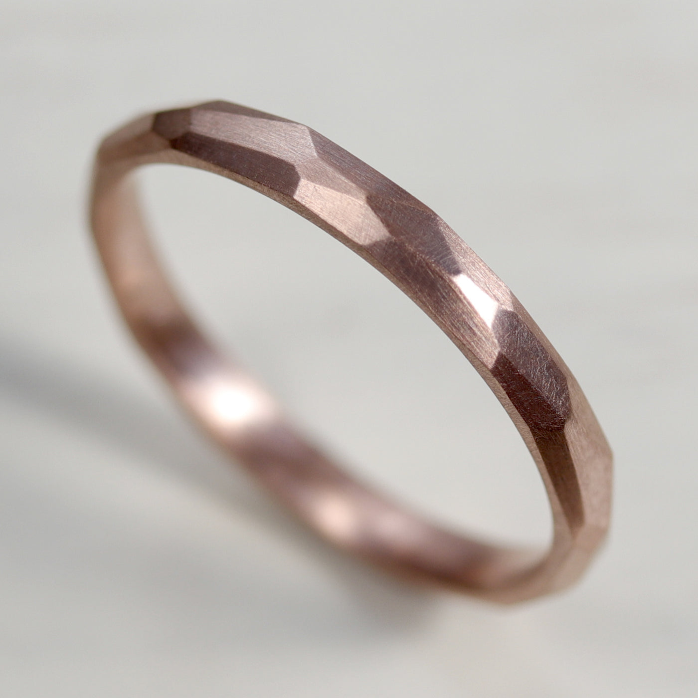 Narrow Smooth Faceted Wedding Band •