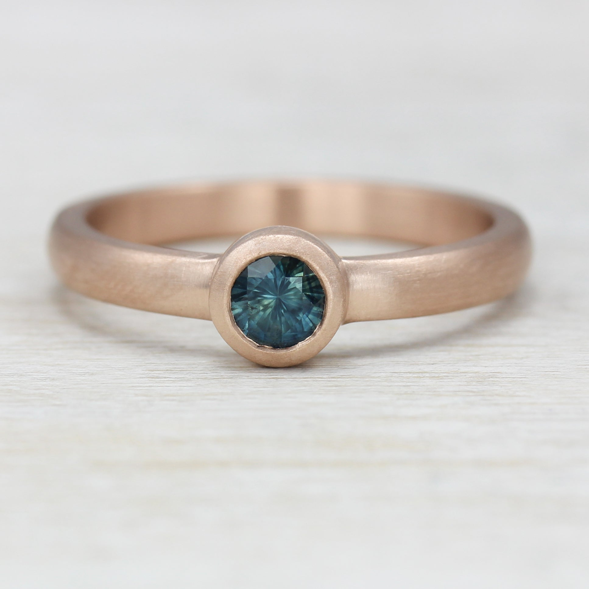 Rose Gold Solitaire with Fair Trade Teal Blue Sapphire