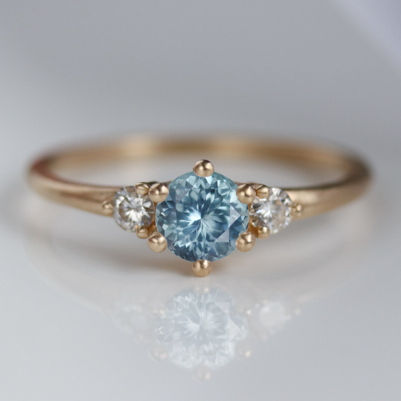 Prong-set Three Stone Ring with Montana Sapphire Center Stone