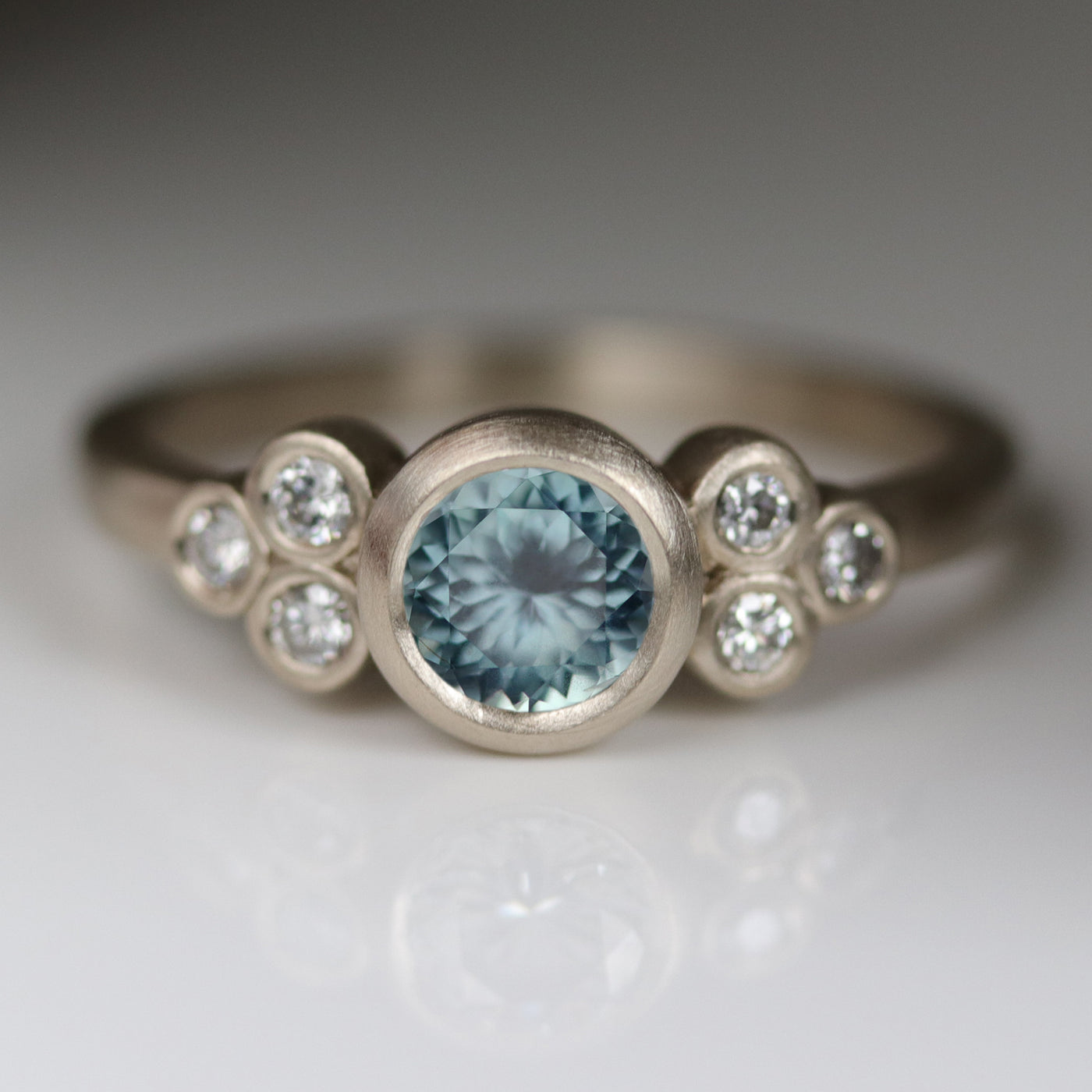 Seven Stone Cluster Ring with Montana Sapphire Center Stone