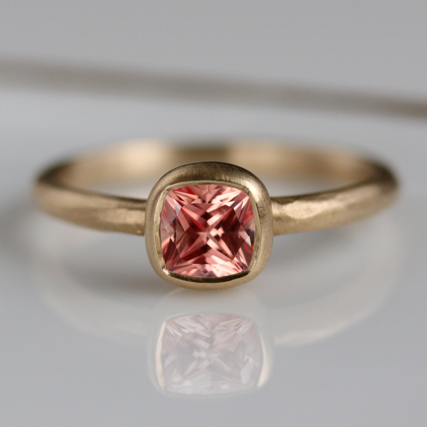 Rustic Cushion Solitaire Ring with Peach Sapphire in Yellow Gold