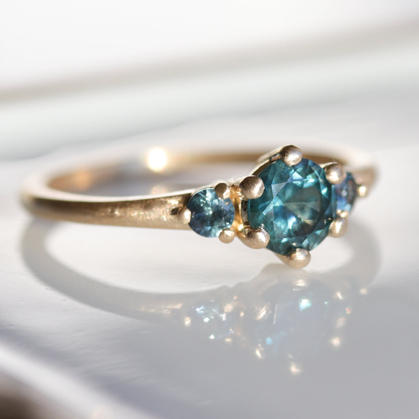 Prong-set Three Stone Ring with Montana Sapphires