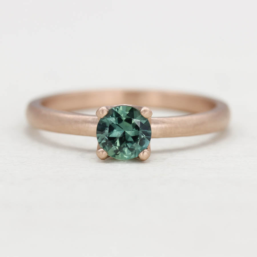 Teal Blue Sapphire and Rose Gold Crown Solitaire
