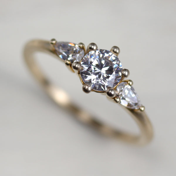 Prong-set Three Stone Ring with Pear-Shaped Side Stones