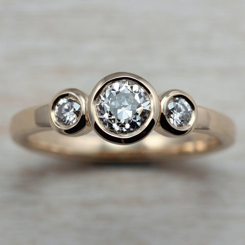 Diamonds and 14k Yellow Gold Three Stone Ring