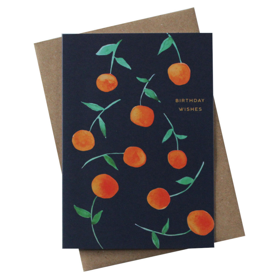 Birthday Wishes blank birthday card, clementines on a navy background, with brown kraft envelope.