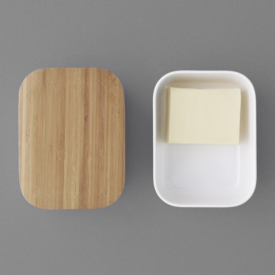 Box-it butter box by RigTig, white containing butter, with the bamboo lid off.