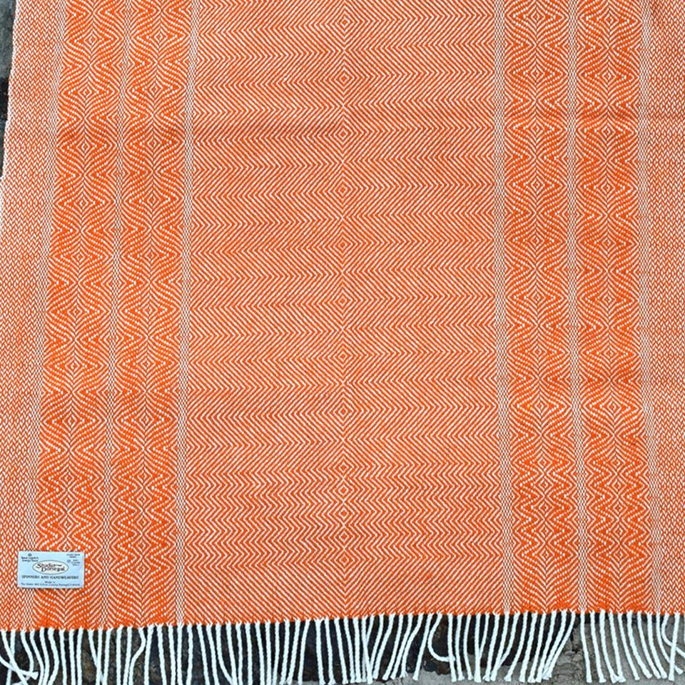 Studio Donegal undulating twill large wool throw, carrot.