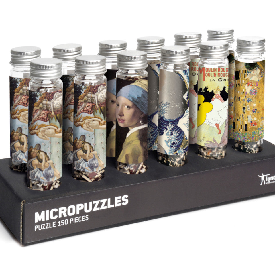 Classical Art micropuzzle mix, l-r: Botticelli, Vermeer, Hokusai, Toulous-Lautrec, and Klimt.