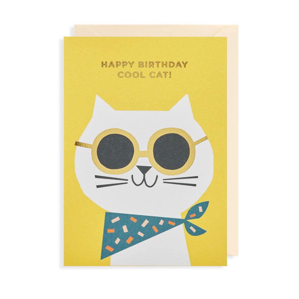 Happy Birthday Cool Cat!, blank birthday card, gold lettering on a yellow background above a grinning cat wearing gold-framed sunglasses and a bandana, with cream envelope.