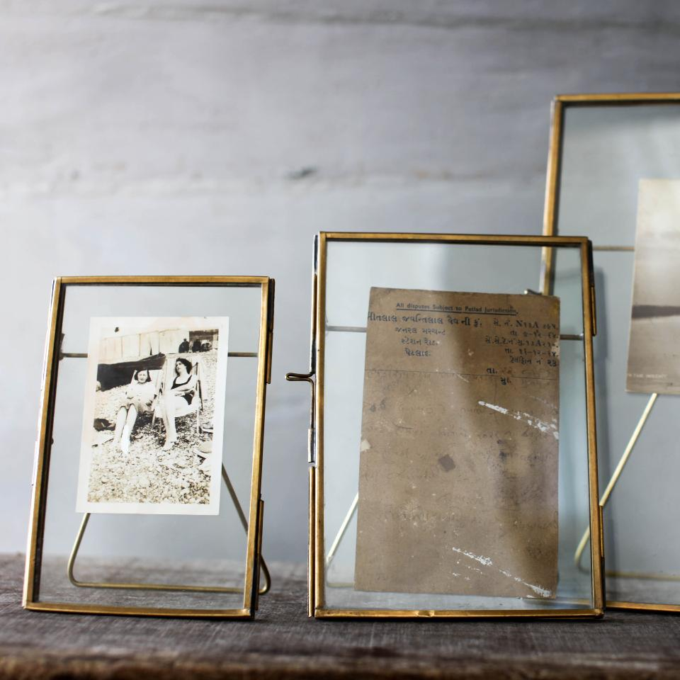 "Danta standing antique brass, 4"" x 6"" and 5"" x 7"" frames, styled."