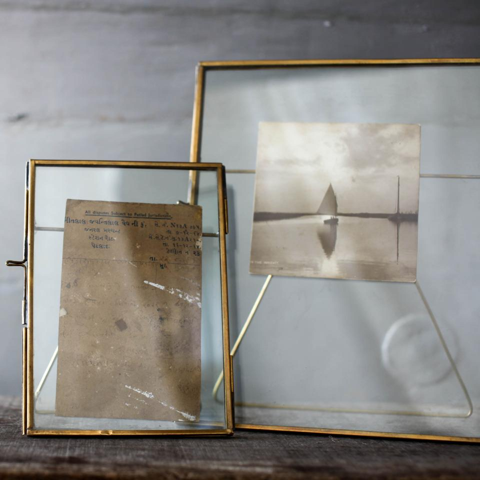 "Danta standing antique brass, 5"" x 7"" and 8"" x 10"" frames, styled."