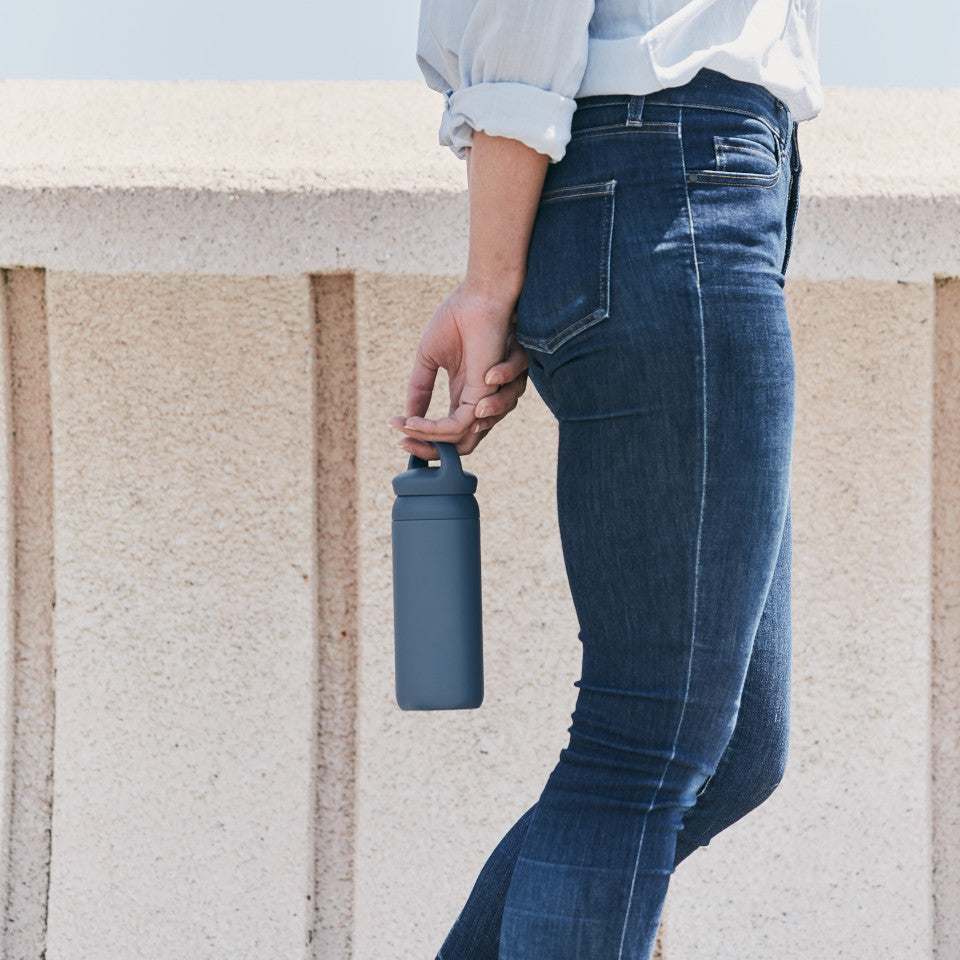 Day Off travel tumbler, blue, styled.