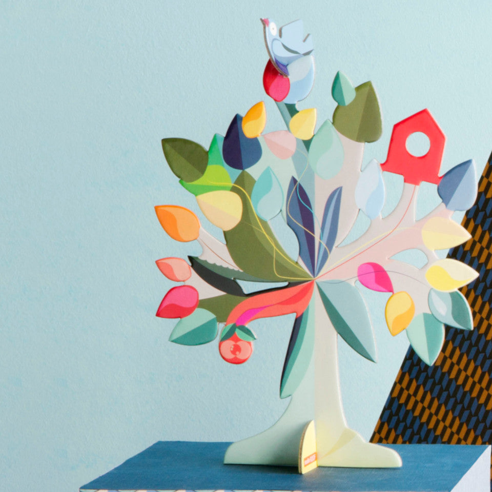 Dream Tree pop out 3D card styled with a blue and patterned backgroundon a dark blue pedestal.