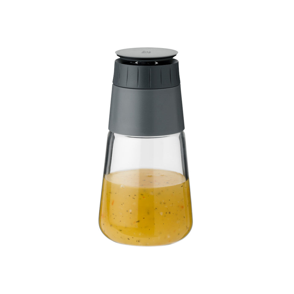 Shake-It by RigTig dressing shaker containing dressing and with the teist cap open.