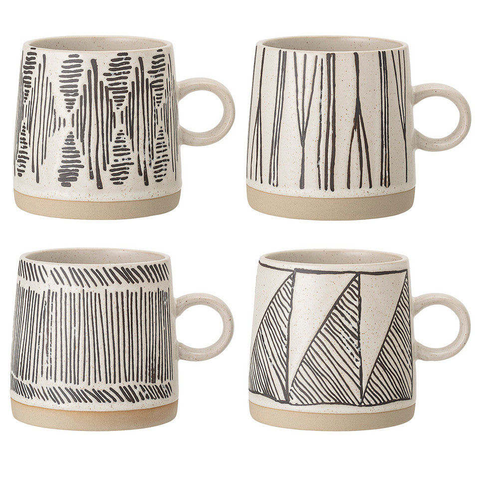 Eliana mugs, four patterns shown together.