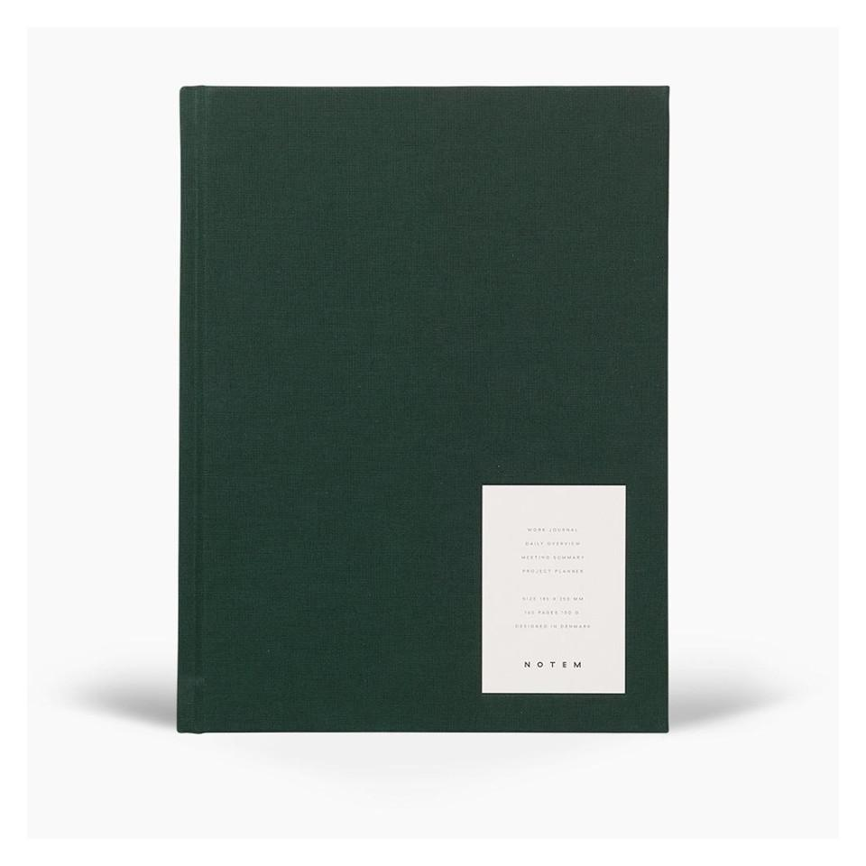 Even work journal with dark green fabric hardcover.