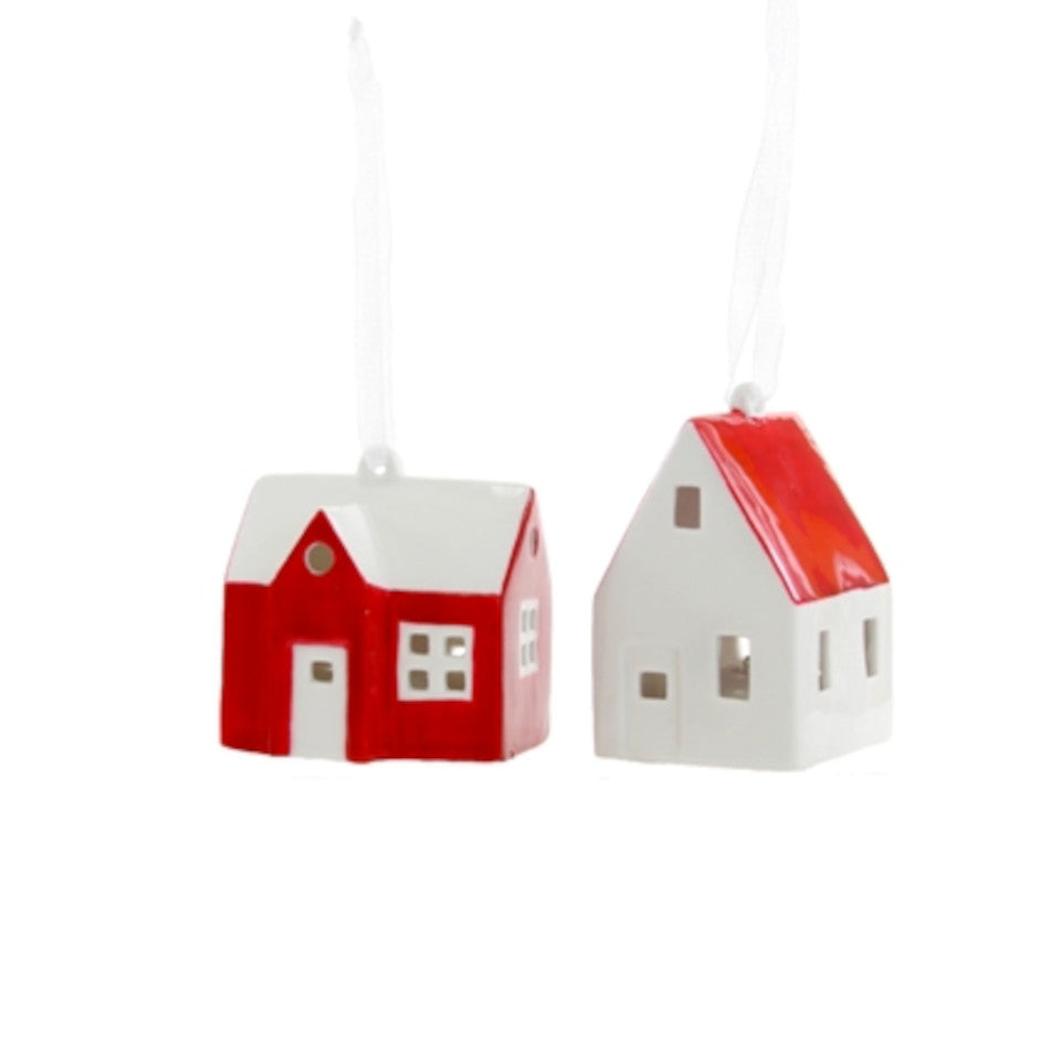 Red and white farmhouses, l-r: red house with white roof; white house with red roof.