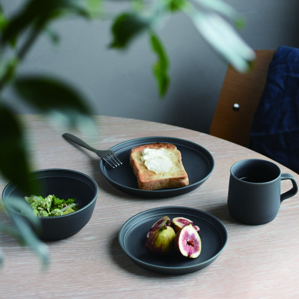 Fog blue porcelain bowl, 20 cm plate, 16 cm plate and mug styled with food.