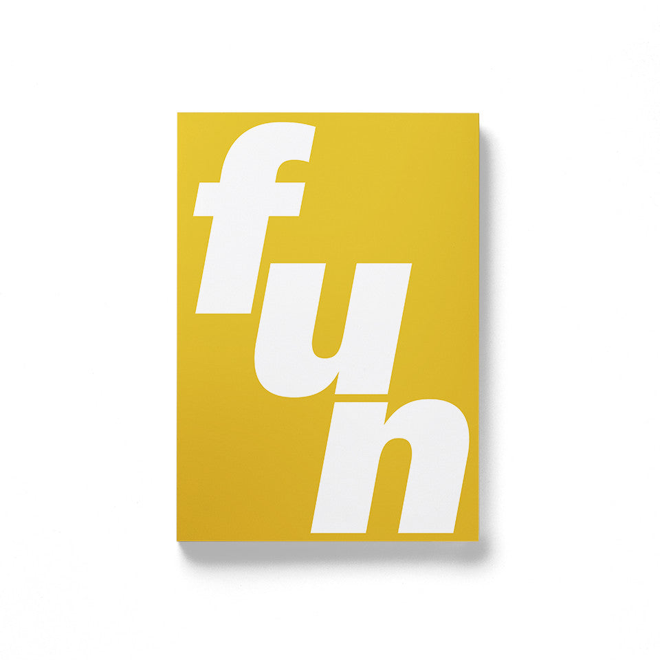 FUN yellow notebook with white lettering.