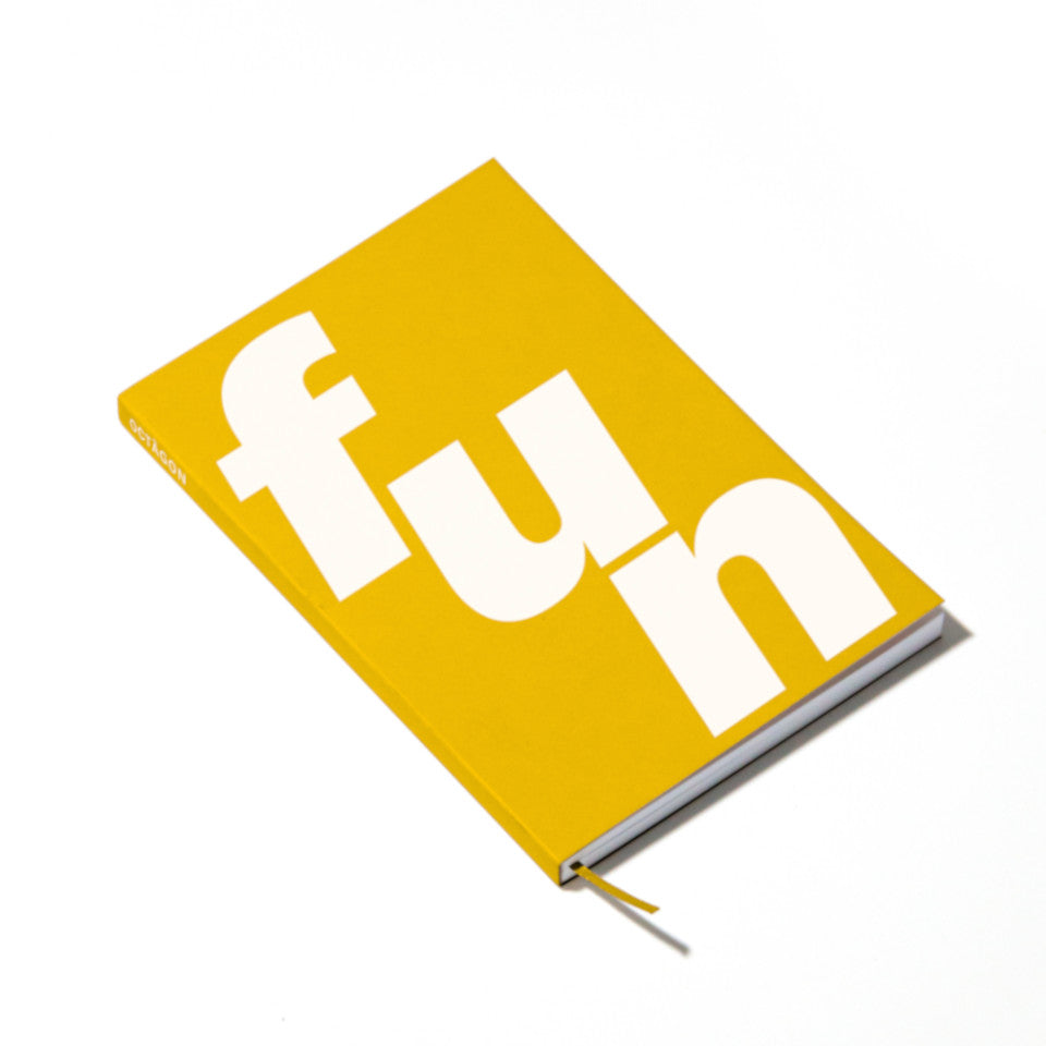 FUN yellow notebook with white lettering, angled view.