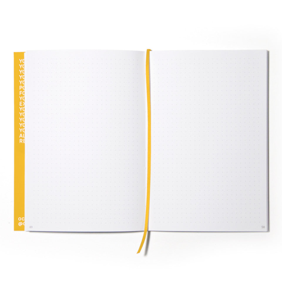 FUN yellow notebook with white lettering, open showing dotted pages.