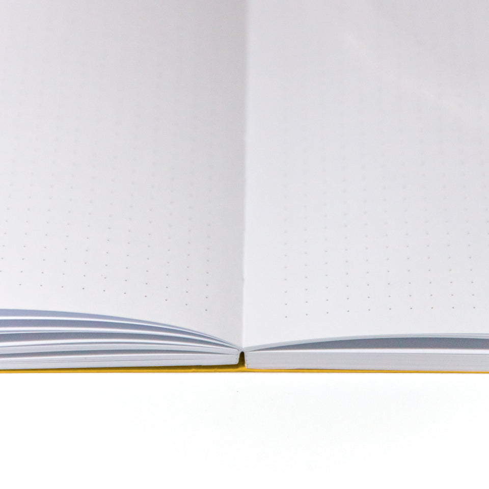 FUN yellow notebook with white lettering, detail of pages.
