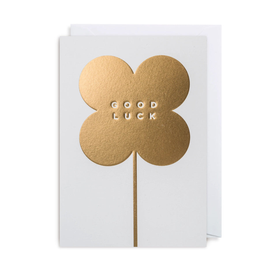 Good Luck, blank good luck card, white lettering on a gold four-leaf clover, on a white background, with white envelope.