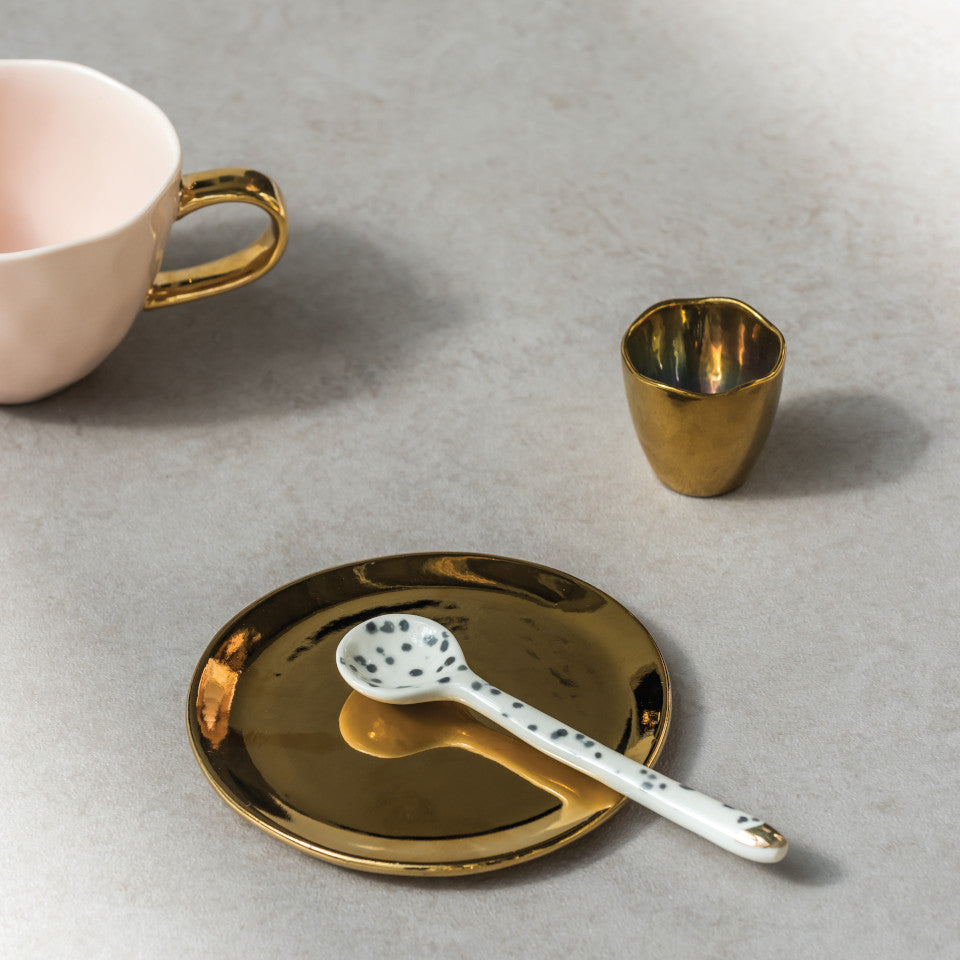 Good Morning gold eggcup, gold plate and pink cup, styled together.