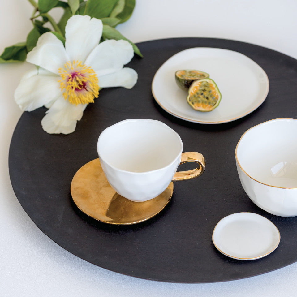 Good Morning gold plate, styled with Good morning white cup, bowl, small and large plates..