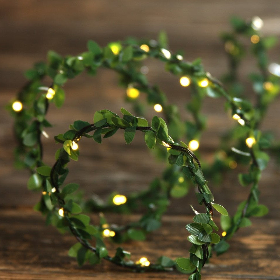 Greenery light chain - battery operated, on a wooden table.