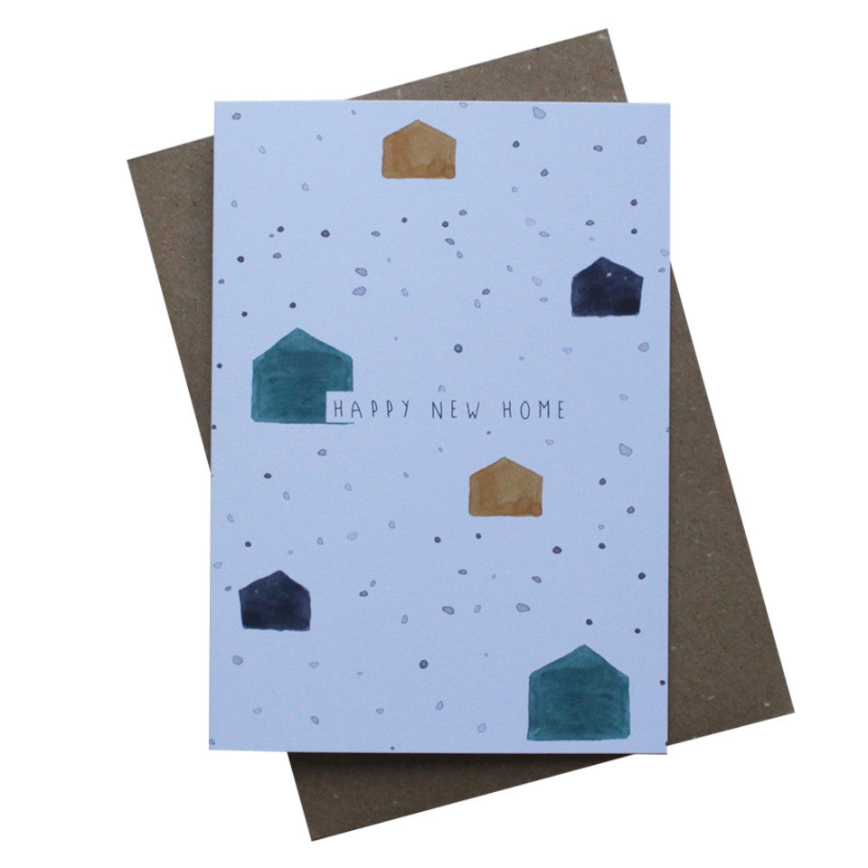 Happy New Home blank greeting card, blue, navy and mustard speckles and basic house shapes on a white background with black text, with brown kraft envelope.