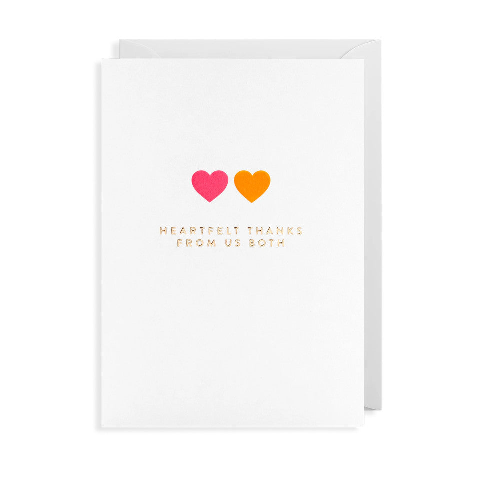Heartfelt Thanks From us Both, blank greeting card, gold lettering under a pink and orange heart, with white envelope.