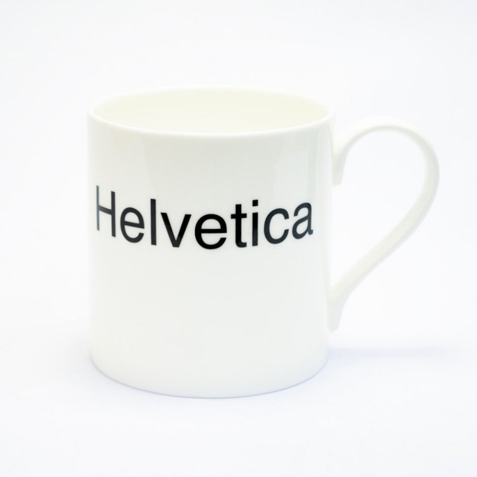Helvetica typographic fine bone china mug, handle on right.