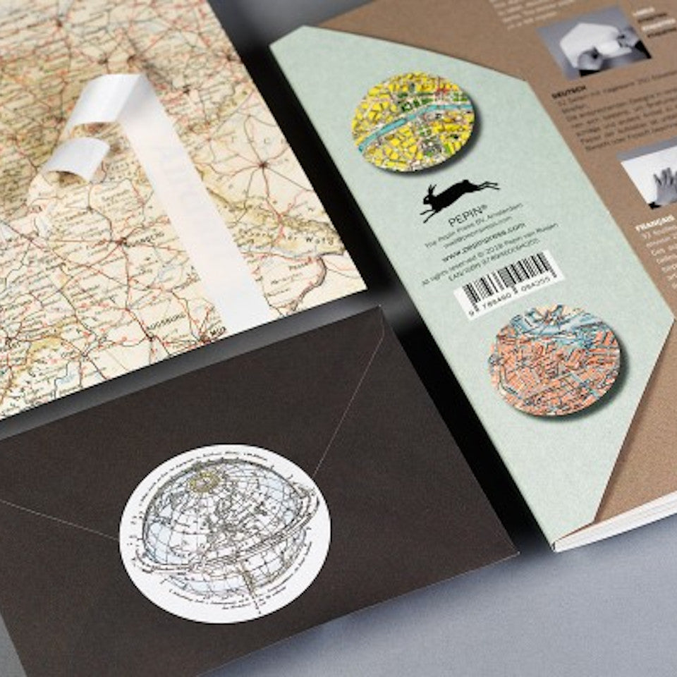Historical maps labels, stickers and tapes craft book, styled with envelope and page detailing tape strips.