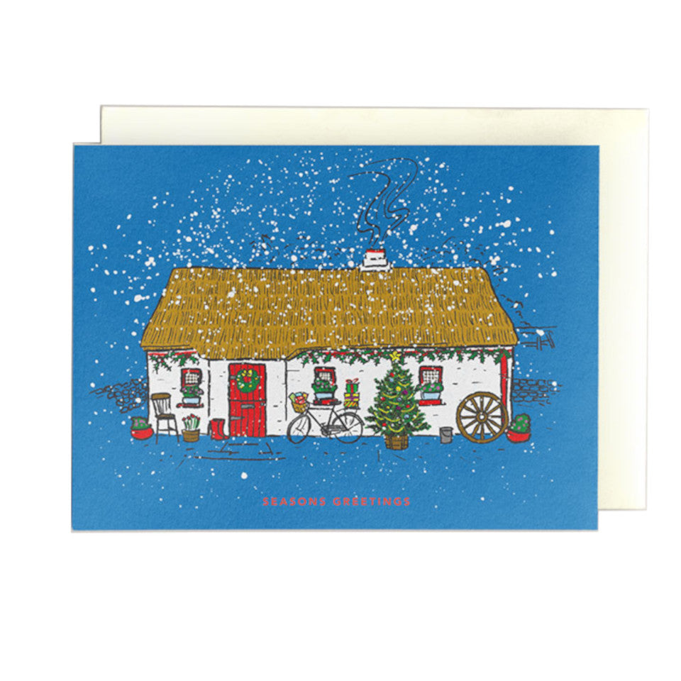 Irish thatched cottage in snowy scene, Season's Greetings, Christmas card.